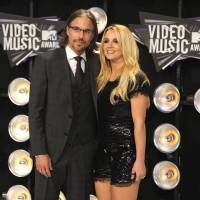Photo - FILE - In this Aug. 28, 2011 file photo, Jason Trawick and Britney Spears arrive at the MTV Video Music Awards in Los Angeles.  A judge says Spears' one-time fiance Jason Trawick has resigned as her co-conservator on Friday Jan. 11, 2013. (AP Photo/Chris Pizzello, file)