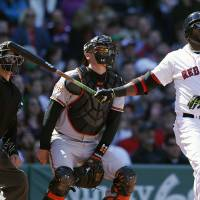 Photo - Boston Red Sox's David Ortiz watches his home run in front of Baltimore Orioles' Matt Wieters in the fourth inning of a  baseball game in Boston, Saturday, April 19, 2014. (AP Photo/Michael Dwyer)
