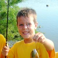 Photo - MURDER / HOMICIDE / SON / CHILD / ARREST: Tommy Wolf, shown in a 2008 photo provided by his Cub Scout pack. Tommy, 9, was killed Monday, Nov. 16, 2009 at his Nichols Hills home, and his father, Stephen Wolf, 51, was arrested on a murder complaint in connection with his death. The home's address is 1715 Elmhurst Ave. PHOTO PROVIDED BY CUB SCOUT PACK 120  ORG XMIT: KOD