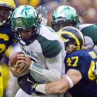 Photo -   Michigan State quarterback Andrew Maxwell (10) is sacked by Michigan linebacker Jake Ryan (47) during the second quarter of an NCAA college football game, Saturday, Oct. 20, 2012, in Ann Arbor, Mich. (AP Photo/Tony Ding)