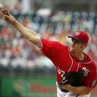Photo - Washington Nationals starting pitcher Stephen Strasburg throws during the first inning of a baseball game against the Philadelphia Phillies at Nationals Park Sunday, Aug. 3, 2014, in Washington. (AP Photo/Alex Brandon)