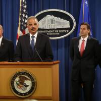 Photo - Attorney General Eric Holder, accompanied by, from left, U.S. Attorney for Western District of Pennsylvania David Hickton,  Assistant Attorney General for National Security John Carlin, and FBI Executive Associate Director Robert Anderson, speaks at a news conference at the Justice Department in Washington, Monday, May 19, 2014. Holder was announcing that a U.S. grand jury has charged five Chinese hackers with economic espionage and trade secret theft, the first-of-its-kind criminal charges against Chinese military officials in an international cyber-espionage case. (AP Photo/Charles Dharapak)