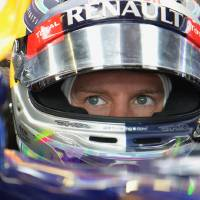 Photo - Red Bull driver Sebastian Vettel of Germany waits in his car in the garage during the first training session in Spielberg, Austria, Friday, June 20, 2014. The Austrian Formula One Grand Prix will be held on Sunday. (AP Photo/Kerstin Joensson)