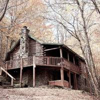 Photo -  A cabin with hot tub, situated high in the Ozark Mountains, can be rented at the Buffalo Outdoor Center in Ponca, Ark. Photo by Rhonda Mills, Buffalo Outdoor Center.  PROVIDED