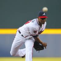 Photo - Atlanta Braves starting pitcher Julio Teheran delivers in the first inning of a baseball game against the Milwaukee Brewers on Tuesday, May 20, 2014, in Atlanta. (AP Photo/Todd Kirkland)