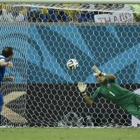 Photo - Costa Rica's goalkeeper Keylor Navas, right, makes a save on Greece's Fanis Gekas' penalty shot during a shootout after regulation time in the World Cup round of 16 soccer match between Costa Rica and Greece at the Arena Pernambuco in Recife, Brazil, Sunday, June 29, 2014. Costa Rica defeated Greece 5-3 in penalty shootouts after a 1-1 tie. (AP Photo/Martin Meissner)