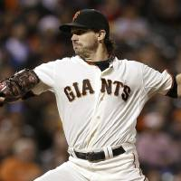 Photo - San Francisco Giants pitcher Barry Zito throws to a Los Angeles Dodgers batter during the third inning of a baseball game in San Francisco, Wednesday, Sept. 25, 2013. (AP Photo/Jeff Chiu)