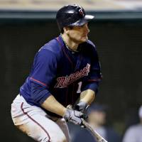 Photo -   Minnesota Twins' Josh Willingham singles to drive in Denard Span in the sixth inning of a baseball game against the Cleveland Indians, Wednesday, Sept. 19, 2012, in Cleveland. (AP Photo/Mark Duncan)