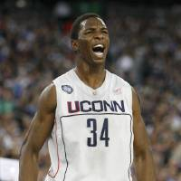 Photo - UCONN / REACTION:  Universitiy of Connecticut's Hasheem Thabeet reacts during a men's NCAA Final Four semifinal college basketball game, Saturday, April,  4, 2009, in Detroit.  (AP Photo/Carlos Osorio) ORG XMIT: FF124