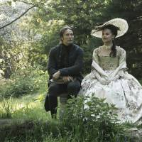 Photo - FILE - This publicity film image released by Magnolia Pictures shows Mads Mikkelsen, left, and Alicia Vikander in a scene from