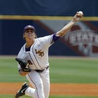 Photo - LSU's Kyle Bouman (28) pitches against Arkansas during the first inning at the Southeastern Conference NCAA college baseball tournament on Saturday, May 24, 2014, in Hoover, Ala. (AP Photo/Butch Dill)