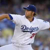 Photo - Los Angeles Dodgers starting pitcher Clayton Kershaw throws to the plate during the first inning of a baseball game against the Atlanta Braves, Thursday, July 31, 2014, in Los Angeles. (AP Photo/Mark J. Terrill)