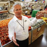 Photo - Steve Black, chief information and marketing officer, talks about the new Sprouts Farmers Market that opened Wednesday in Norman. PHOTO BY STEVE SISNEY, THE OKLAHOMAN  STEVE SISNEY