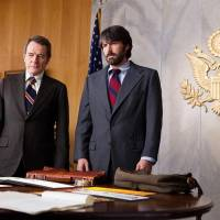 """Photo -  This film image released by Warner Bros. Pictures shows Bryan Cranston, left, as Jack OíDonnell and Ben Affleck as Tony Mendez in """"Argo,""""  a rescue thriller about the 1979 Iranian hostage crisis. (AP Photo/Warner Bros., Claire Folger) ORG XMIT: NYET605"""