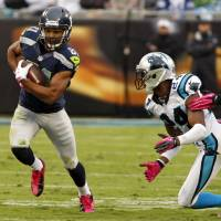 Photo -   Seattle Seahawks' Golden Tate (81) runs past Carolina Panthers' Josh Norman (24) during the first quarter of an NFL football game in Charlotte, N.C., Sunday, Oct. 7, 2012. (AP Photo/Nell Redmond)