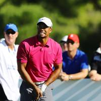 Photo - Tiger Woods of the United States tees off from the 10th hole during the third round of the Turkish Open golf tournament at the Montgomerie Maxx Royal Course in Antalya, Turkey, Saturday, Nov. 9, 2013. (AP Photo/Kaan Soyturk)