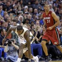 Photo - Utah Jazz's Marvin Williams (2) celebrates after hitting a 3-pointer while Miami Heat's Shane Battier (31) looks away during the first quarter of an NBA basketball game Saturday, Feb. 8, 2014, in Salt Lake City. (AP Photo/Rick Bowmer)