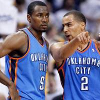 Photo - Oklahoma City Thunder guard Thabo Sefolosha (2), of Switzerland, talks with Serge Ibaka (9) during the second half of Game 6 against the Memphis Grizzlies in a second-round NBA basketball playoff series on Friday, May 13, 2011, in Memphis, Tenn. The Grizzlies won 95-83 to even the series 3-3. (AP Photo/Lance Murphey)