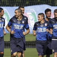 Photo - Italy's players train in Mangaratiba, Brazil, Tuesday, June 17, 2014. Italy plays in group D at the 2014 soccer World Cup. (AP Photo/Antonio Calanni)