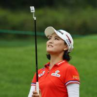 Photo - So Yeon Ryu of South Korea reacts to her putt on the second hole during the third round of the Canadian Women's Open golf tournament in London, Ontario, on Saturday, Aug. 23, 2014. (AP Photo/The Canadian Press, Dave Chidley)