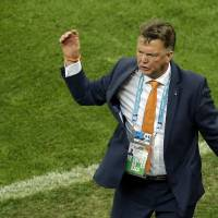 Photo - Netherlands' head coach Louis van Gaal gestures during the World Cup third-place soccer match between Brazil and the Netherlands at the Estadio Nacional in Brasilia, Brazil, Saturday, July 12, 2014. (AP Photo/Themba Hadebe)