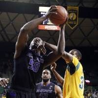 Photo - Kansas State forward D.J. Johnson (50) is fouled by Baylor forward Cory Jefferson, right, in the first half of an NCAA college basketball game Saturday, Feb. 15, 2014, in Waco, Texas. (AP Photo/The Waco Tribune-Herald, Rod Aydelotte)