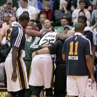 Photo - Utah Jazz center Al Jefferson (25) is helped off the court after being injured in the fourth quarter during an NBA basketball game against the Orlando Magic Wednesday, Dec. 5, 2012, in Salt Lake City. The Jazz defeated the Magic 87-81. (AP Photo/Rick Bowmer)