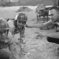 Photo - In this undated photo released by Forward Entertainment, Filipino director Borinaga Alix Jr., right, instructs actors on the set of his film