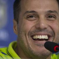 Photo - Brazil's goalkeeper Julio Cesar answers questions during a news conference at the Granja Comary training center in Teresopolis, Brazil, Tuesday, May 27, 2014. Brazil is hosting the World Cup soccer tournament which starts in June. (AP Photo/Felipe Dana)
