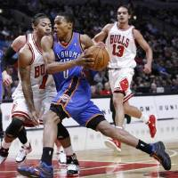 Photo -  Derrick Rose (left) might be running away with the MVP award. But some think Russell Westbrook is just as, if not more, worthy.