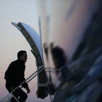 Photo -   Republican presidential candidate and former Massachusetts Gov. Mitt Romney boards his plane in Norfolk, Va., Friday, Nov. 2, 2012, as he travels to campaign events in Milwaukee, Wis. (AP Photo/Charles Dharapak)