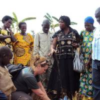 Photo - Sharon Allen of Piedmont, founder of Apples for Africa, plants an apple tree with a group of Rwandans. Photo provided