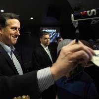 Photo -   Republican presidential candidate, former Pennsylvania Sen. Rick Santorum visits with supporters during during a campaign rally at the New Life Assembly of God, Thursday, March 1, 2012, in Spokane, Wash. (AP Photo/Eric Gay)