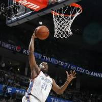 Photo - Oklahoma City's  Damien  Wilkins (21) shoots a layup during the NBA basketball game between the Oklahoma City Thunder and Philadelphia 76ers at the Ford Center, Sunday, March 8, 2009, in Oklahoma City . PHOTO BY SARAH PHIPPS