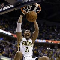 Photo - Indiana Pacers forward David West gets a dunk to give the Pacers a 4-point lead during overtime of an NBA basketball game against the Portland Trail Blazers in Indianapolis, Friday, Feb. 7, 2014. The Pacers defeated the Trail Blazers 118-113. (AP Photo/Michael Conroy)