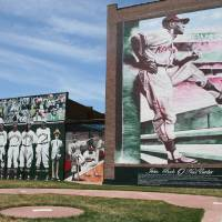 Photo - Portraits of the old-time Negro Leagues greats are painted on the wall of the old Paseo YMCA, where the leagues were first conceived.  DAVE CATHEY - THE OKLAHOMAN