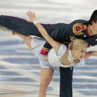 Photo - Tatiana Volosozhar and Maxim Trankov of Russia compete in the pairs short program figure skating competition at the Iceberg Skating Palace during the 2014 Winter Olympics, Tuesday, Feb. 11, 2014, in Sochi, Russia. (AP Photo/Ivan Sekretarev)