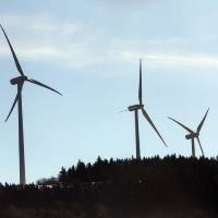 Photo - In this photo taken Tuesday Jan. 28, 2014 wind turbines are seen in Rumney, N.H. On Wednesday Jan. 29, 2014 New Hampshire lawmakers defeated a temporary ban on new wind turbines and electric transmission line projects.(AP Photo/Jim Cole)