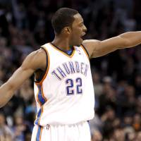 Photo - CELEBRATION: Oklahoma City's Jeff Green (22) celebrates a Thunder score during the NBA basketball game between the Oklahoma City Thunder and the Indiana Pacers, Saturday, Jan. 9, 2010 at the Ford Center in Oklahoma City. Photo by Sarah Phipps, The Oklahoman ORG XMIT: KOD