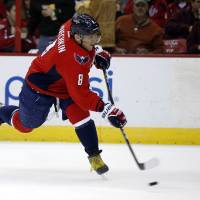 Photo - Washington Capitals right wing Alex Ovechkin (8), from Russia, scores a goal in the first period of an NHL hockey game against the Nashville Predators, Saturday, Dec. 7, 2013, in Washington. (AP Photo/Alex Brandon)