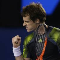Photo - Britain's Andy Murray reacts during his  semifinal match against Switzerland's Roger Federer at the Australian Open tennis championship in Melbourne, Australia, Friday, Jan. 25, 2013. (AP Photo/Dita Alangkara)