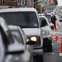 Photo -   FILE- In this Nov. 2, 2012 file photo, cars wait in a 30 block long line for gas in the Brooklyn borough of New York. New York Mayor Michael Bloomberg and officials in the Long Island counties of Nassau and Suffolk have decided to start an even-odd gas rationing plan beginning at 5 a.m. Friday, Nov. 9, 2012. (AP Photo/Seth Wenig, File)