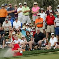 Photo - Luke Donald, of England, hits out of a bunker on the 13th hole in his match against Matteo Manassero, of Italy, during the first round of the Match Play Championship golf tournament on Wednesday, Feb. 19, 2014, in Marana, Ariz. Manassero won 5 and 4. (AP Photo/Matt York)
