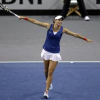 Photo - France's Caroline Garcia celebrates after defeating United States' Sloane Stephens 6-3, 6-2 in a Fed Cup singles world group match Saturday, April 19, 2014, in St. Louis. (AP Photo/Jeff Roberson)