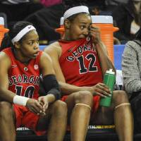 Photo - Georgia forward Jasmine Hassell (12) and guard Jasmine James (10) wait out the end against Kentucky during the second half of an NCAA college basketball game in the Southeastern Conference tournament on Saturday, March 9, 2013, in Duluth, Ga. Kentucky won 60-38. (AP Photo/John Amis)