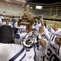 Photo - CELEBRATION / TROPHY: Star Spencer celebrates after winning the Class 4A high school football state championship game betweeen Star Spencer and Douglass at Boone Pickens Stadium in Stillwater, Okla., Saturday, December 5, 2009. Photo by Bryan Terry, The Oklahoman ORG XMIT: KOD
