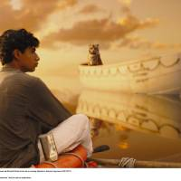"Photo - Pi (Suraj Sharma) is cast away with a ferocious Bengal tiger in ""Life of Pi."" TWENTIETH CENTURY FOX PHOTO"