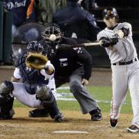 Photo - FILE - In this Oct. 28, 2012, file photo, San Francisco Giants' Marco Scutaro hits an RBI single during the 10th inning of Game 4 of baseball's World Series against the Detroit Tigers in Detroit. Two people with knowledge of the negotiations said Tuesday, Dec. 4, that Scutaro is weighing a two-year contract offer from the Giants that includes a vesting option. (AP Photo/Charlie Riedel, File)