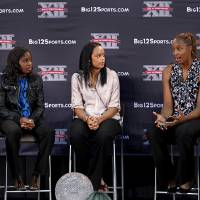 Photo - Kansas' Carolyn Davis, second from right, answers a question Wednesday afternoon, Oct. 19, 2011, during the Big 12 Conference women's basketball media day in Kansas City, Mo. Davis is joined on stage by, from left, Sydney Carter of Texas A&M, Aaryn Ellenberg of Oklahoma, Casey Morris of Texas Tech and Kyley Simmons of Missouri. (AP Photo/The Kansas City Star, Rich Sugg) ORG XMIT: MOKAS303