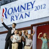 Photo - Republican vice presidential nominee, Rep. Paul Ryan, joined by his family, from left, Charlie, mother Betty Ryan Douglas, wife Janna, Sam and Liza, waves after his acceptance speech during the Republican National Convention in Tampa, Fla., on Wednesday, Aug. 29, 2012. (AP Photo/Charles Dharapak)